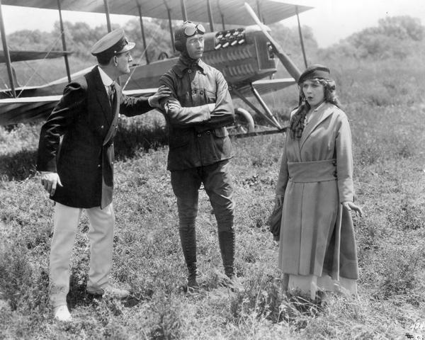 """Donald Crisp, Glenn Martin, and Mary Pickford in the 1915 silent comedy """"A Girl of Yesterday""""   .    A Martin Model TT biplane is behind them.  ( Wisconsin Center for Film and Theater Research )"""