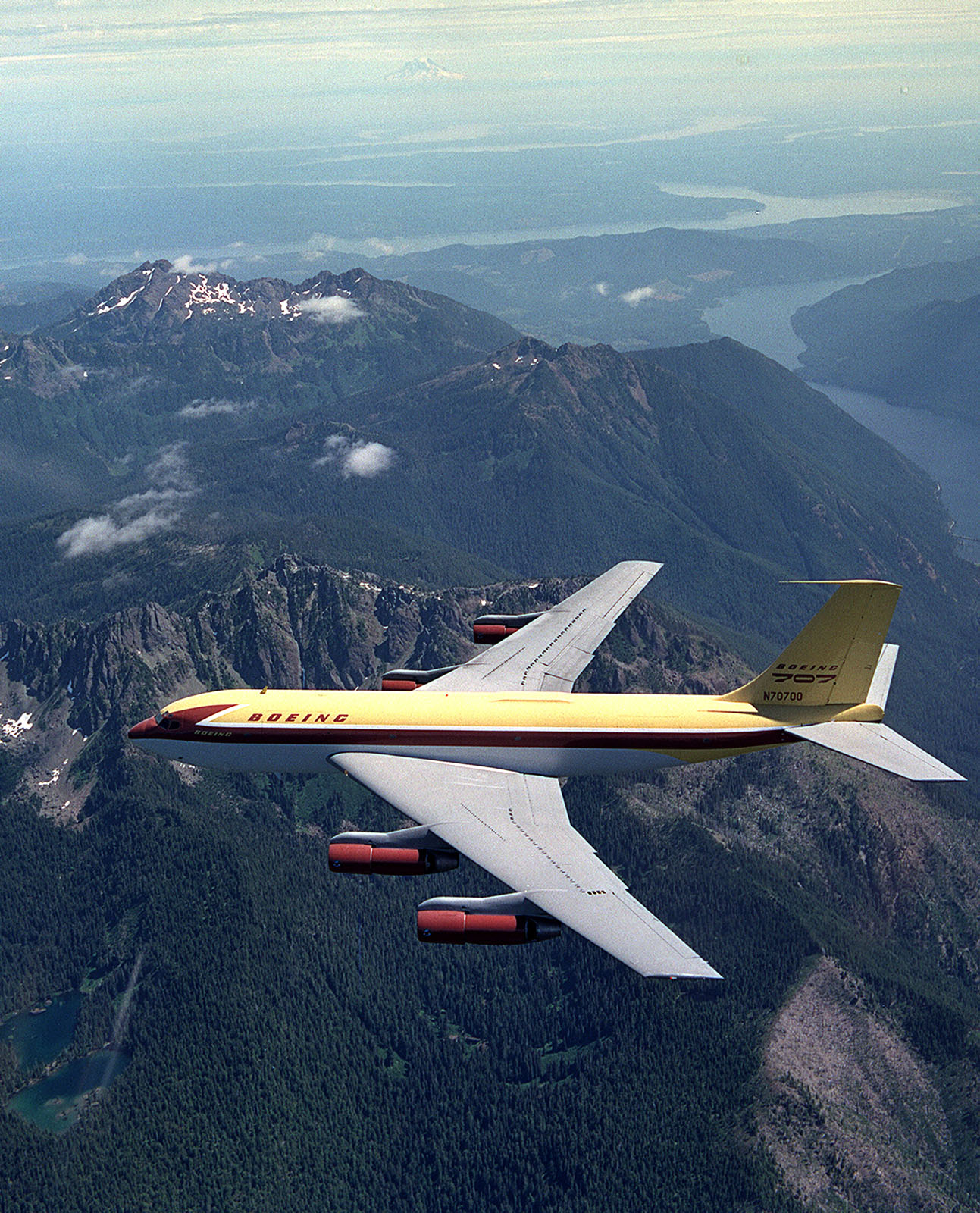 The Dash 80 flies over the Olympic Penninsula on its way to the Smithsonian in 2003  (Joe Parke)