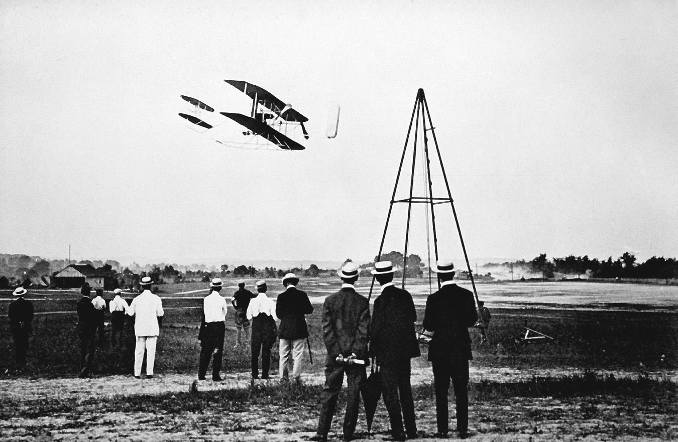 The Wright Brothers test fly their aircraft on Fort Myer's parade field.