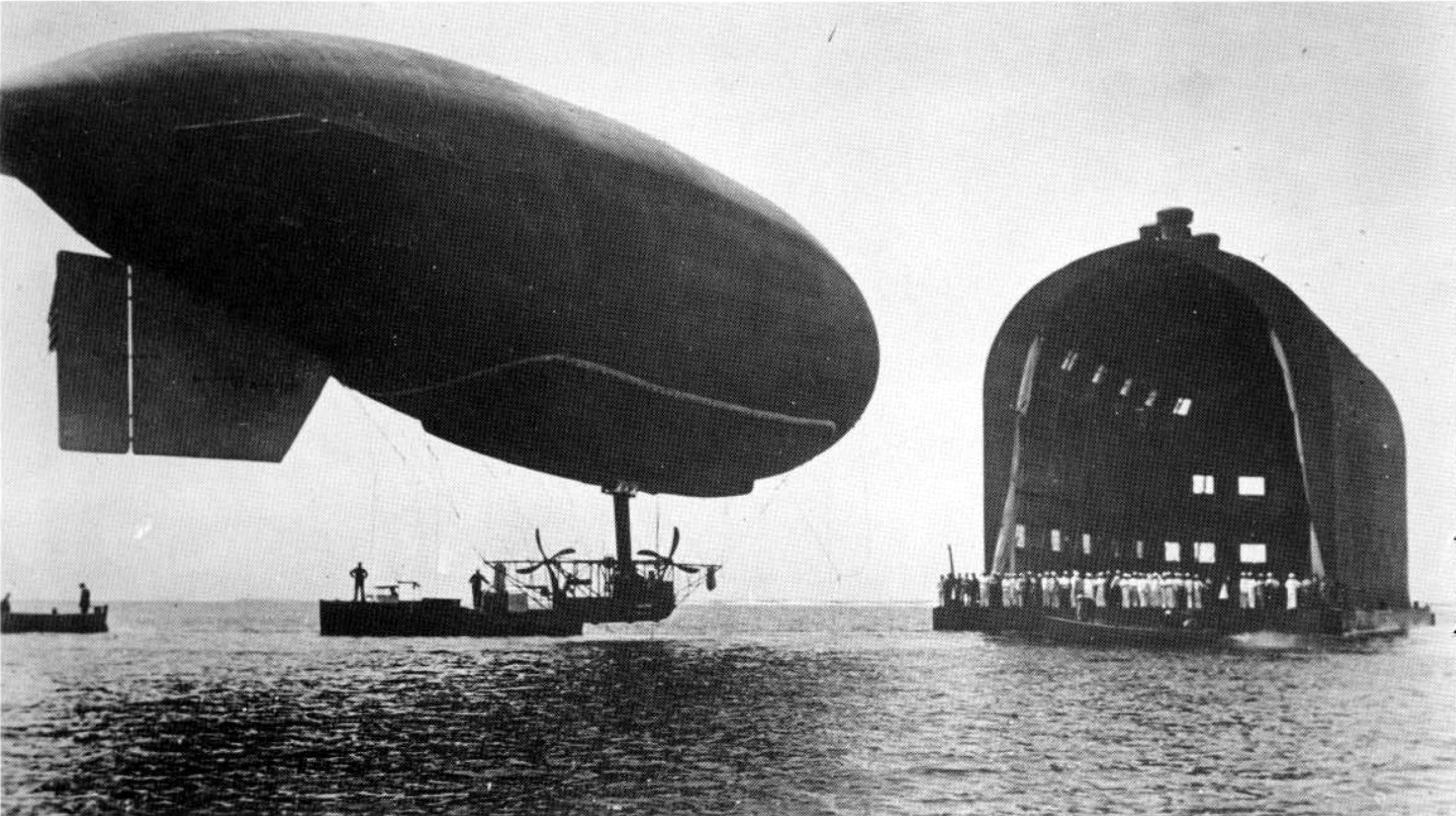 The DN-1 dirigible being guided to its floating hangar in Pensacola, Florida.