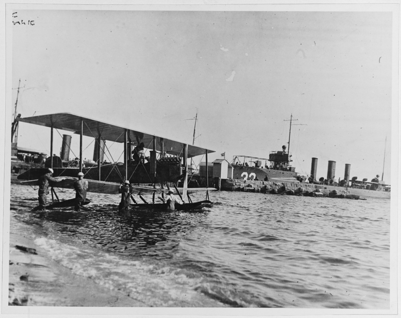 A Martin Model S seaplane with the USS Monaghan to its right circa 1916.   (U.S. Naval History and Heritage Command Photograph)