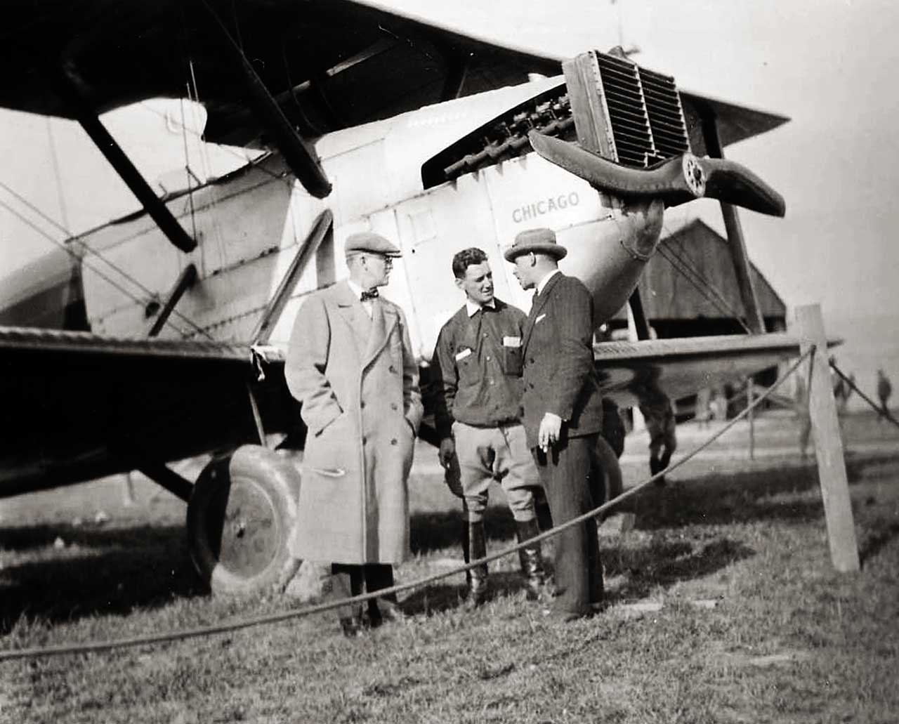 Bill Boeing (at left) visits the crew and craft of the World Flight.  (San Diego Air & Space Museum)