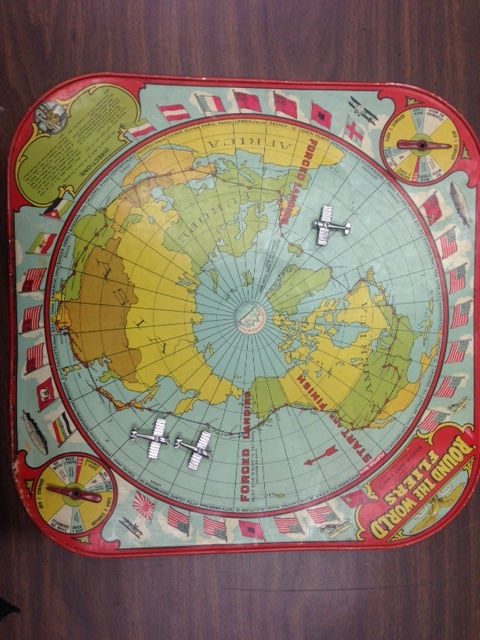 "An original 1926 board game "" Aeroplane Race: 'Round the World Fliers""  was donated to us by PJ. The game is based on the route of the Douglas World Cruiser's historic flight."
