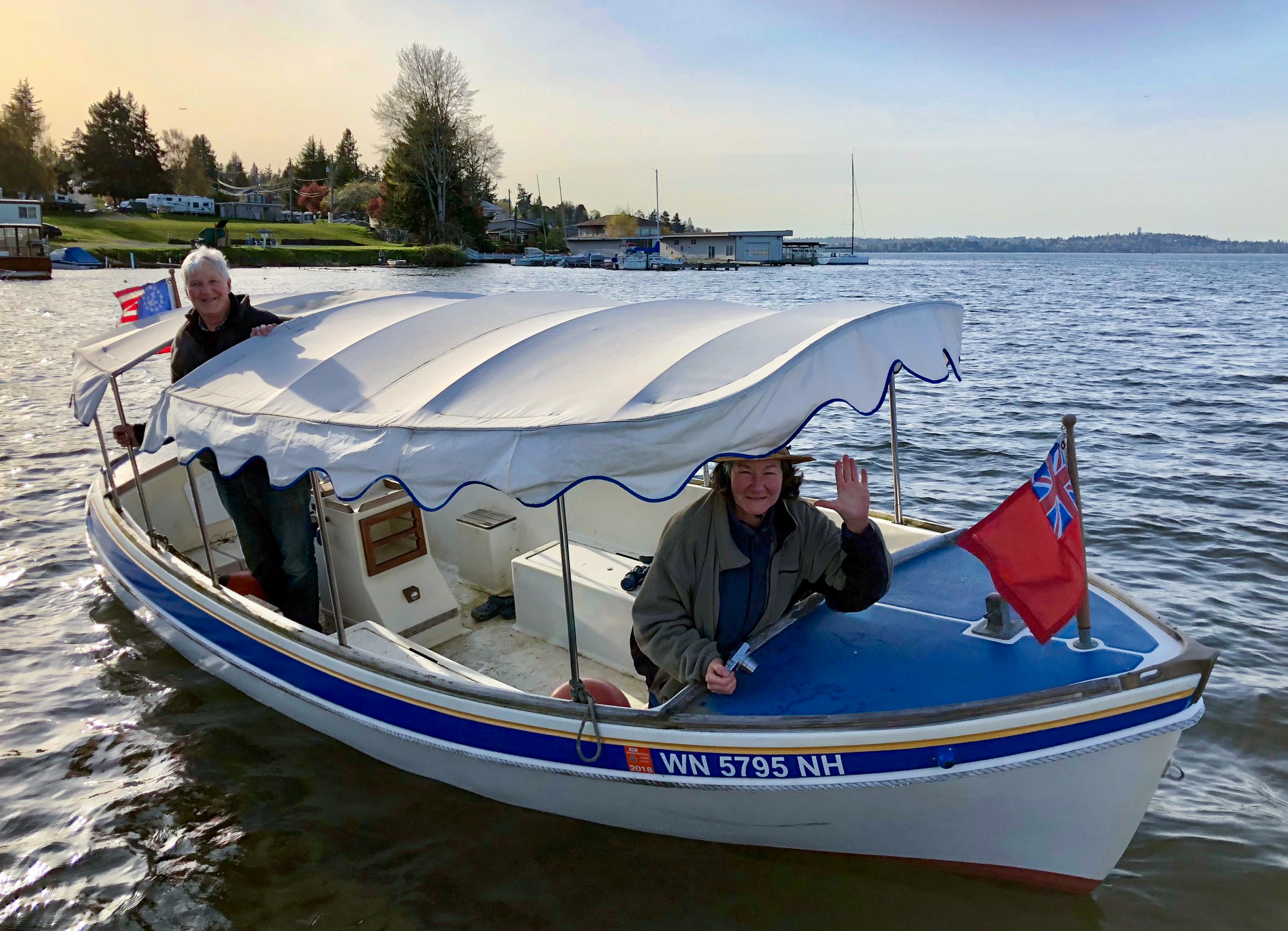 "John & Joellen Hope and their boat ""Electra"""