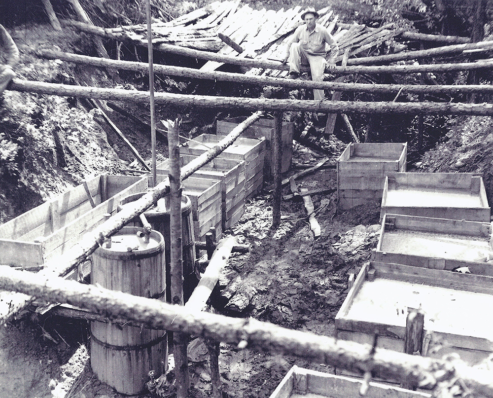 Large underground moonshine still operation. Located in Call section Wilkes County, circa 1950.