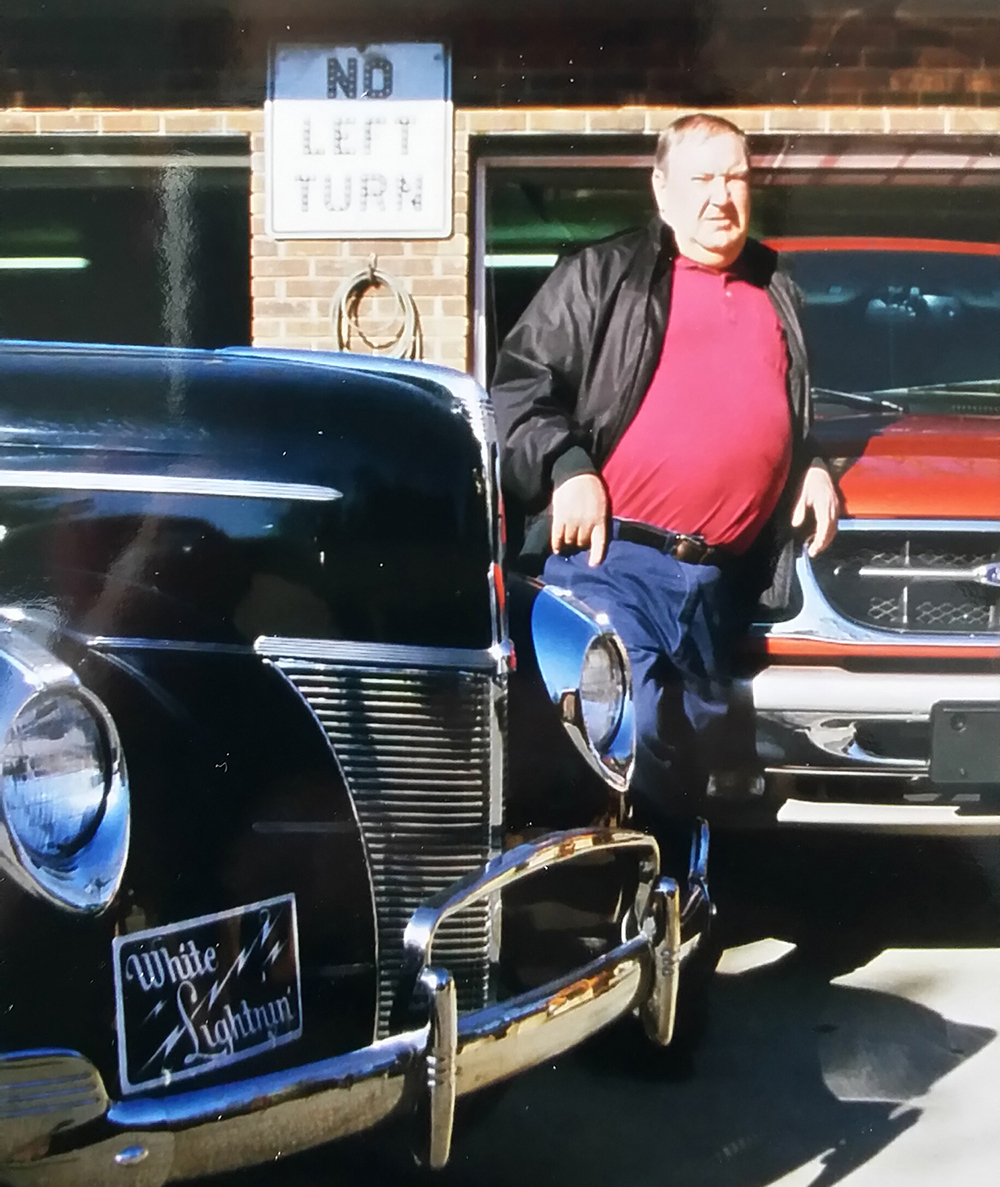 "Willie Clay Call, with one of his ""White Lightnin"" 1940 Fords."