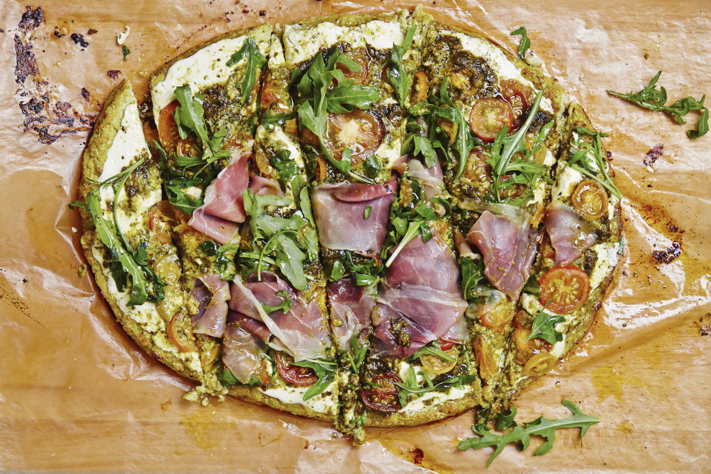 Cauliflower Pizza with Prosciutto, Tomato & Pesto (GF)