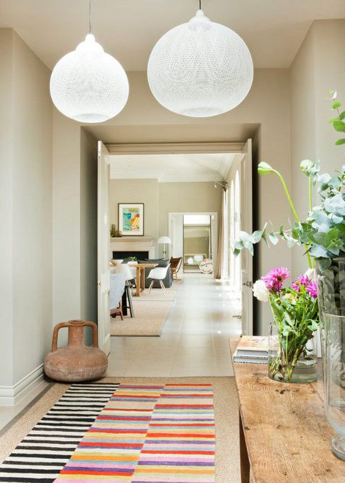 -via Home and Interiors - great pop of color on top of a natural fiber.