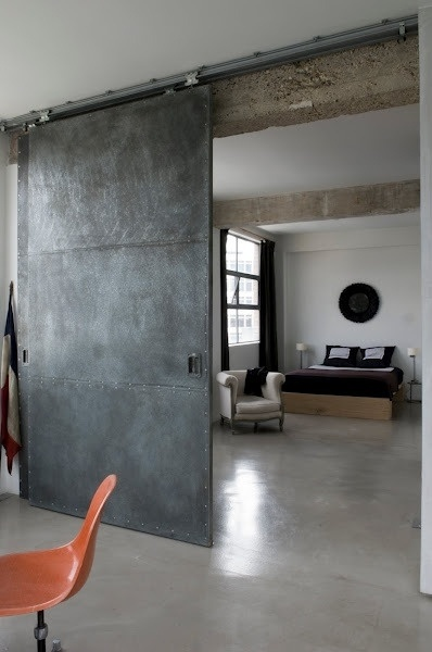 -via misterthree.com (definitely not for most homes, but it works with the polished concrete floors and the exposed beams in this large space)