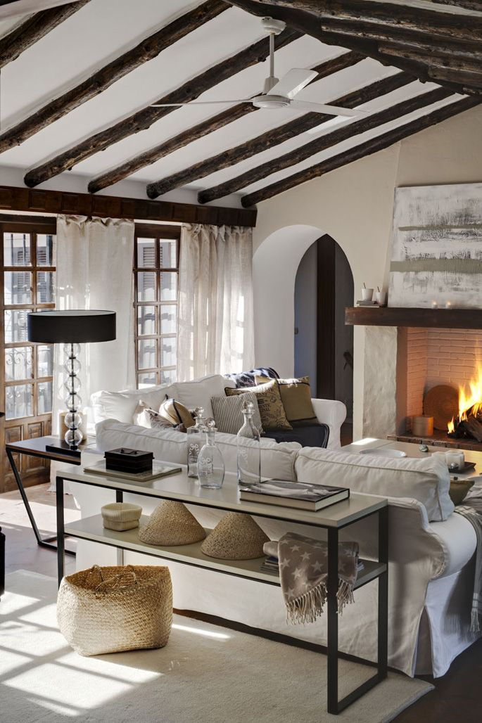 -via Chic and Deco - The wood beams and lots of layers/texture make this neutral room super warm and cozy. Quick, grab a book and a cup of hot chocolate!