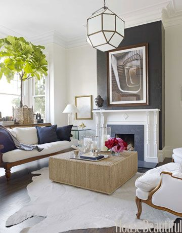 -via housebeautiful.com / I really like the vibe of this room, but the fireplace is not the reason (don't love the woodwork or the wide, gray tiles).