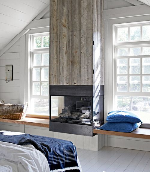 -via countryliving.com / Speaking of storage, this one's chimney is faced with reclaimed white pine, which hides a flat-screen TV!  That way, no one has to know that you watch The Daily Show in bed every night.