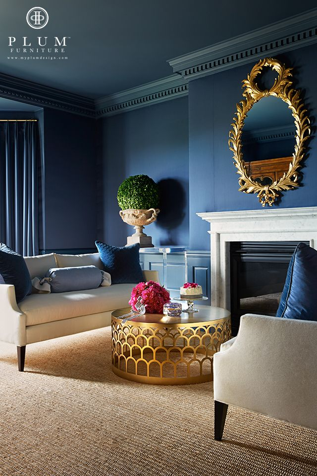 -www.myplumdesign.com / I think the two shades of blue make a beautiful backdrop for their toned-down furniture pieces.