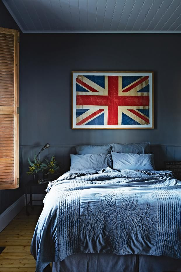 via  domainehome.com  / Such a cool bedroom. Love the framed flag against the gray/blue walls.