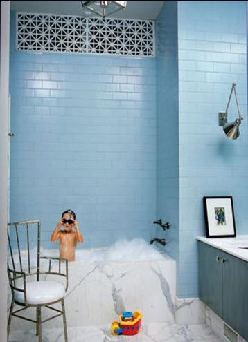 -designed by Kelly Wearstler / These blue subway tiles really make an impact.