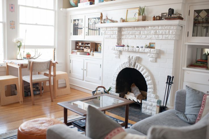 -refinery29.com / The 600 sq. ft. SF apt. of Andrea Cheng. I love the fireplace and built-ins - a focal point and great storage all wrapped into one!