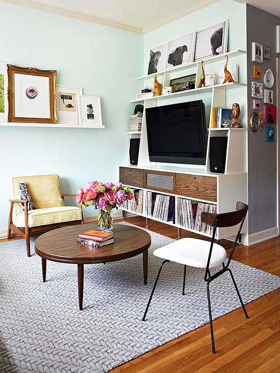 via bhg.com / You can even have a big flat-screen in a tiny place!  Surrounding it with shelves and objects distracts from it's size.