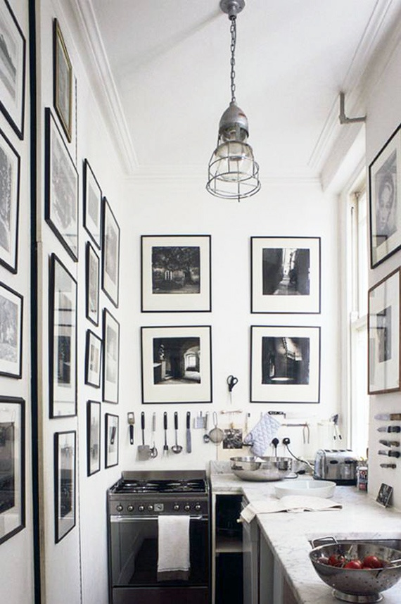 -via alamodeus.net / The gallery-style black-and-white photography makes such a statement in this tiny galley kitchen