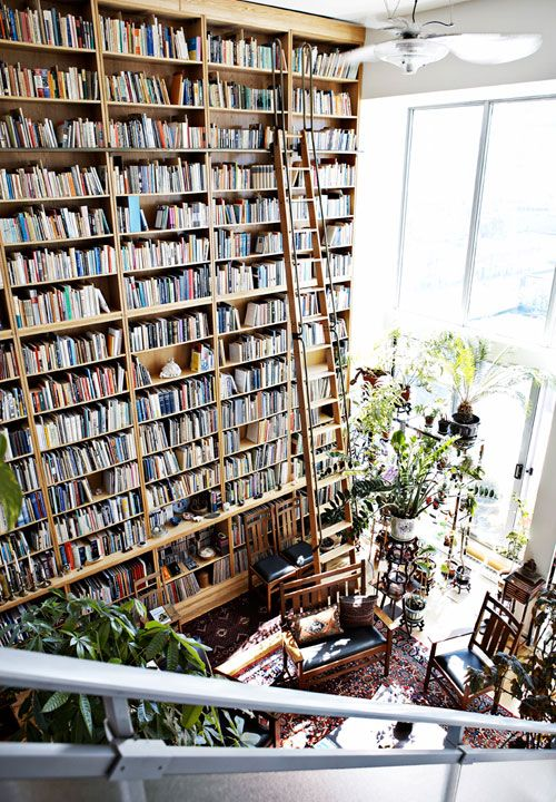 -via Pinterest / Who ARE these people? That's a very impressive collection of literature!