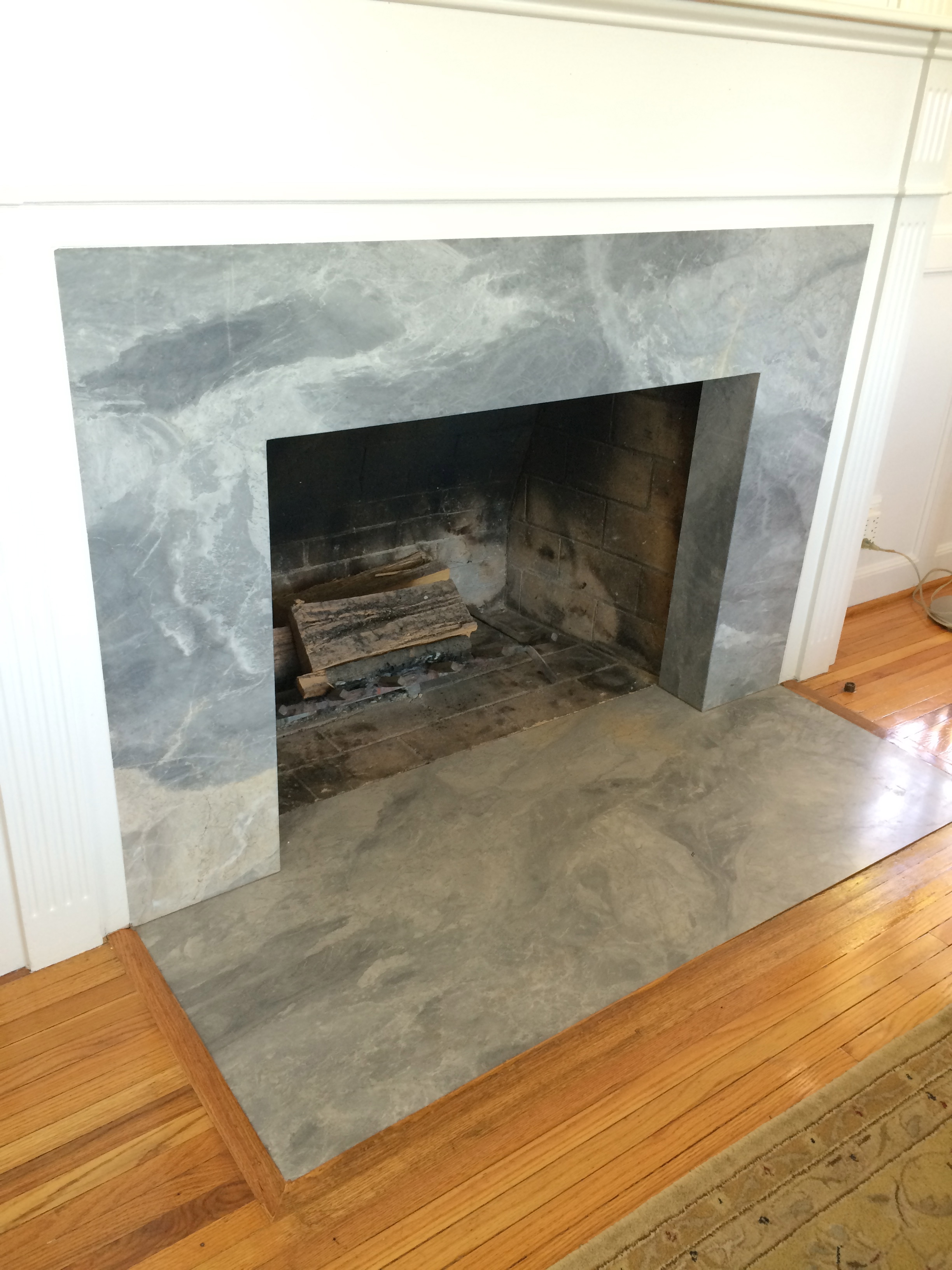 Fireplace- AFTER / Grigio Cafe Marble Honed via Walker Zanger