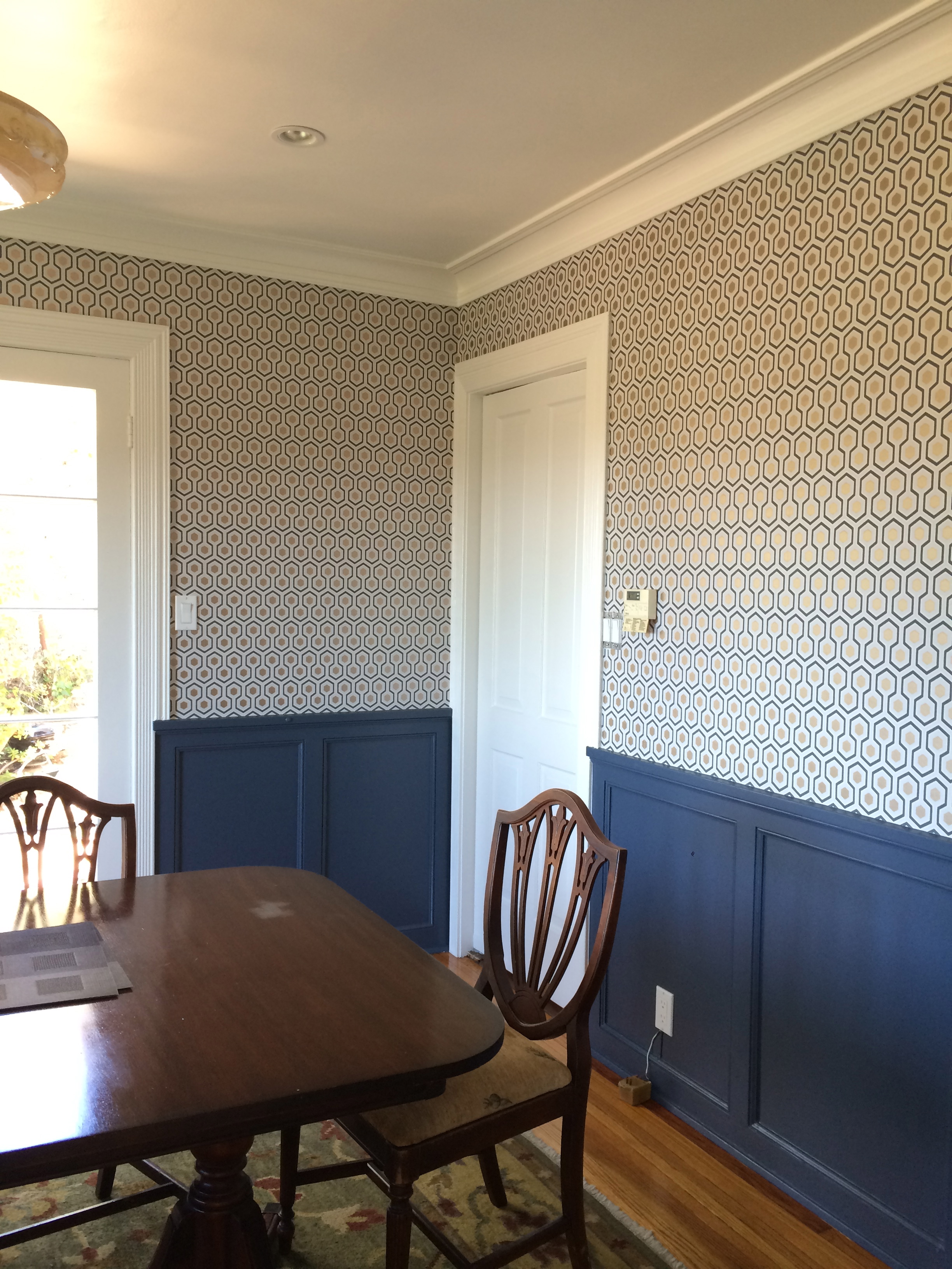 "Dining Room - AFTER / We used all Benjamin Moore Aura paints -  Decorator's White  on trim and ceiling, and  Evening Dove  on the wainscoting and built-ins. We ordered the ""Hicks Hexagon"" wallpaper through Walnut."