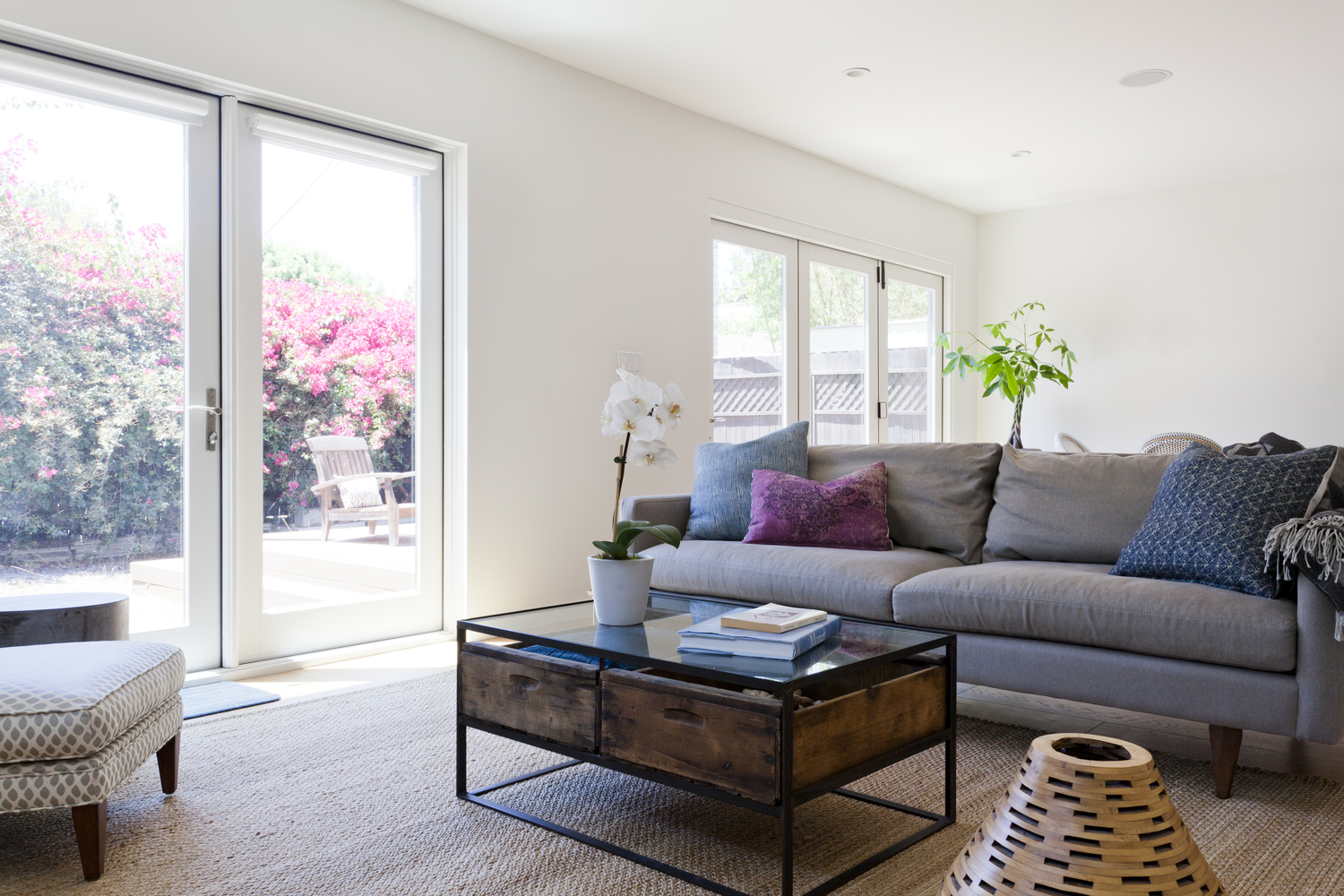 AFTER - This family room is where the family spends most of their time. It's super comfortable and casual, with tons of natural light. - photo by  Heather Culp