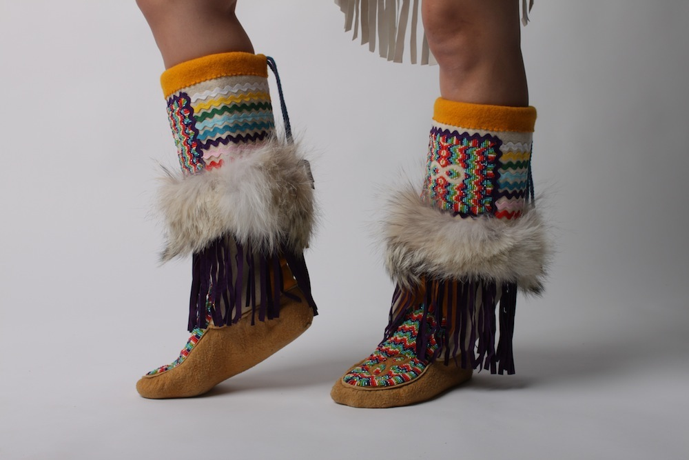 Métis   Explosion Mukluks, 2012, Native/home tanned moose hide, purple pigskin, coyote fur, melton, ric rac, and glass beads. Photos:   Jeneen Frei Njootli