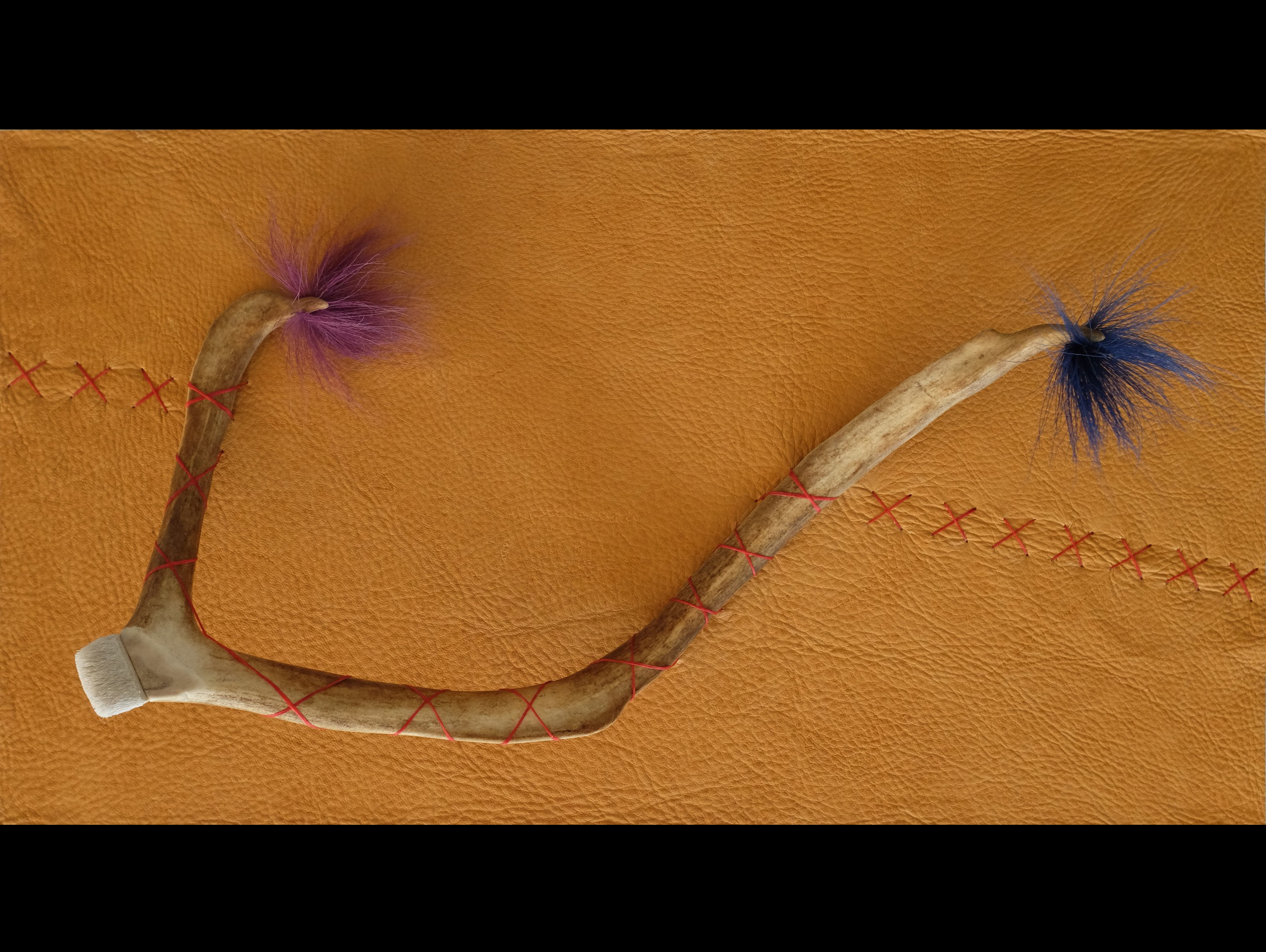 """Traces, 2014, caribou antler, caribou hair, and sinew on elk hide,  11"""" x 20"""" x 5"""""""