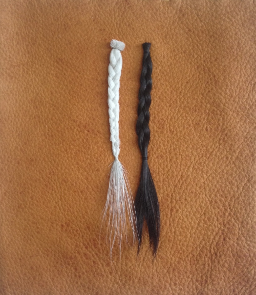 """iamthecaribou/thecaribouisme, 2014, caribou hair andthe artist's hair on elk hide, 8"""" x 9""""."""
