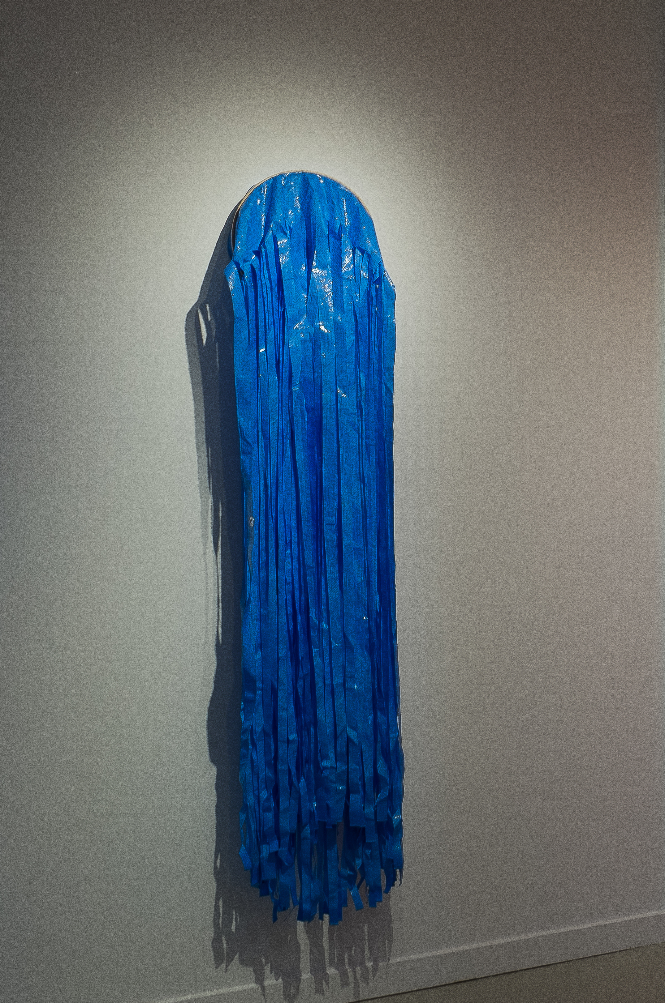 """the outer seam 1, tarp and embroidery hoop, 72"""" x 14.25"""", 2016."""