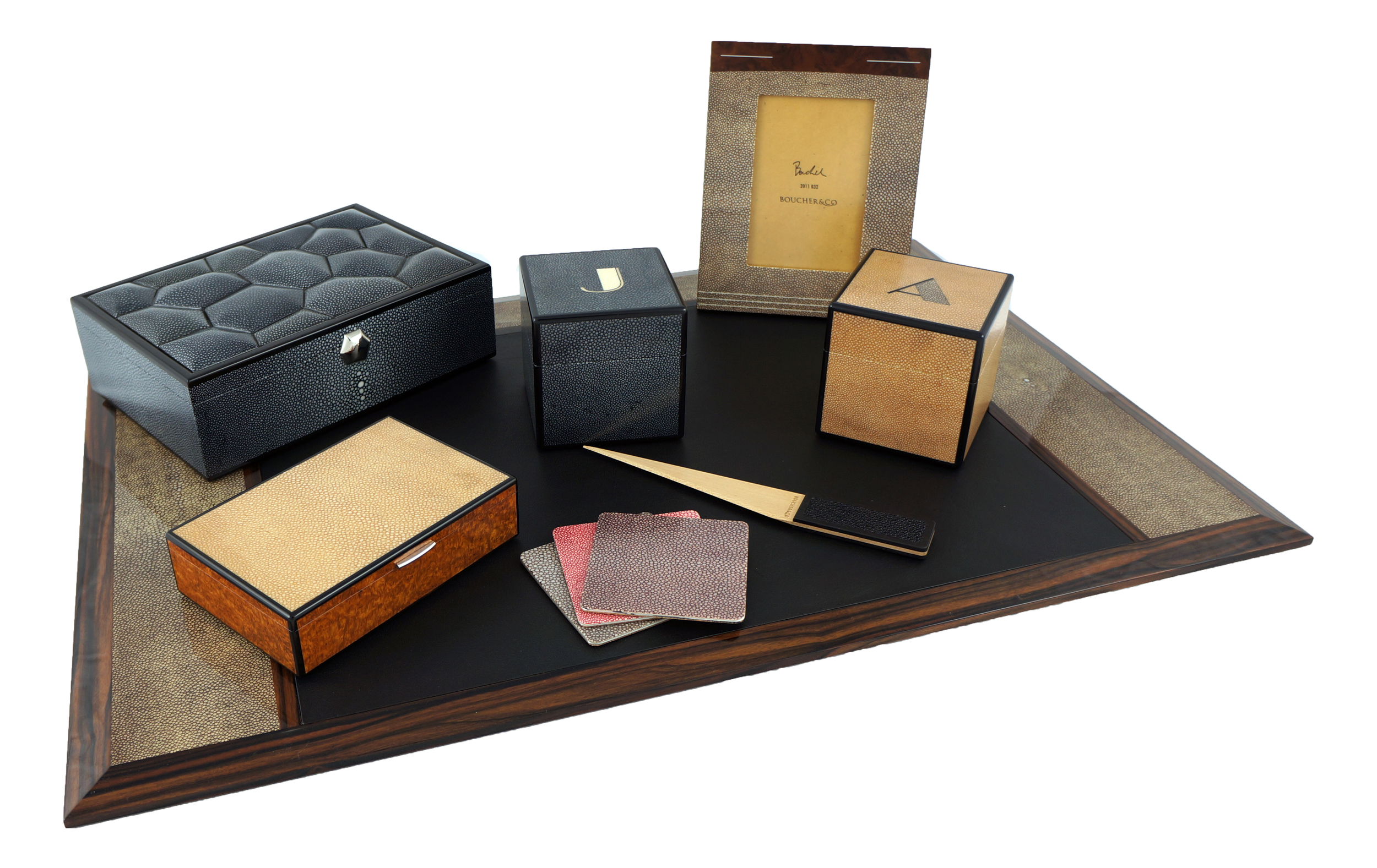 A selection of Keepsake, Jewel, and Initial boxes, with a photo frame and part of a Desk set.