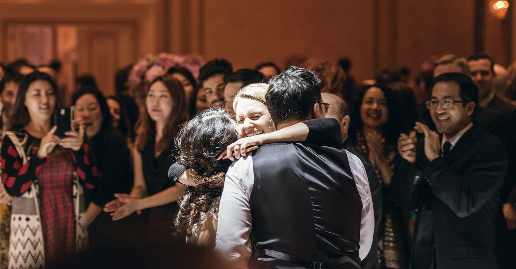 Jane, Harryand Dance Instructor Murisa in a celebratory hug after they wowed all of their guests with a show stopping first dance!! Congratulations you two!