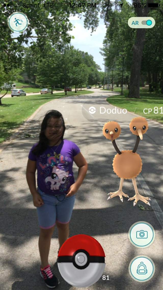 Aki Mercado in Riverside parks catching Pokemon GO. Photo by Alameda Bail Bonds in Tulsa