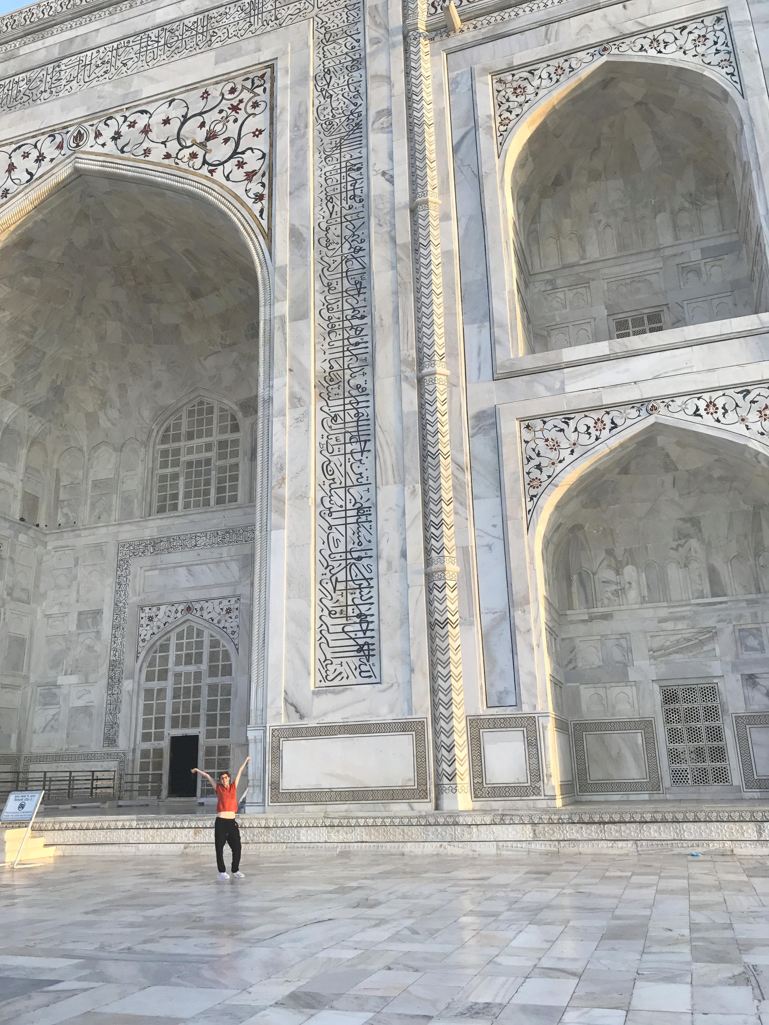 the huge white entrance of the Taj