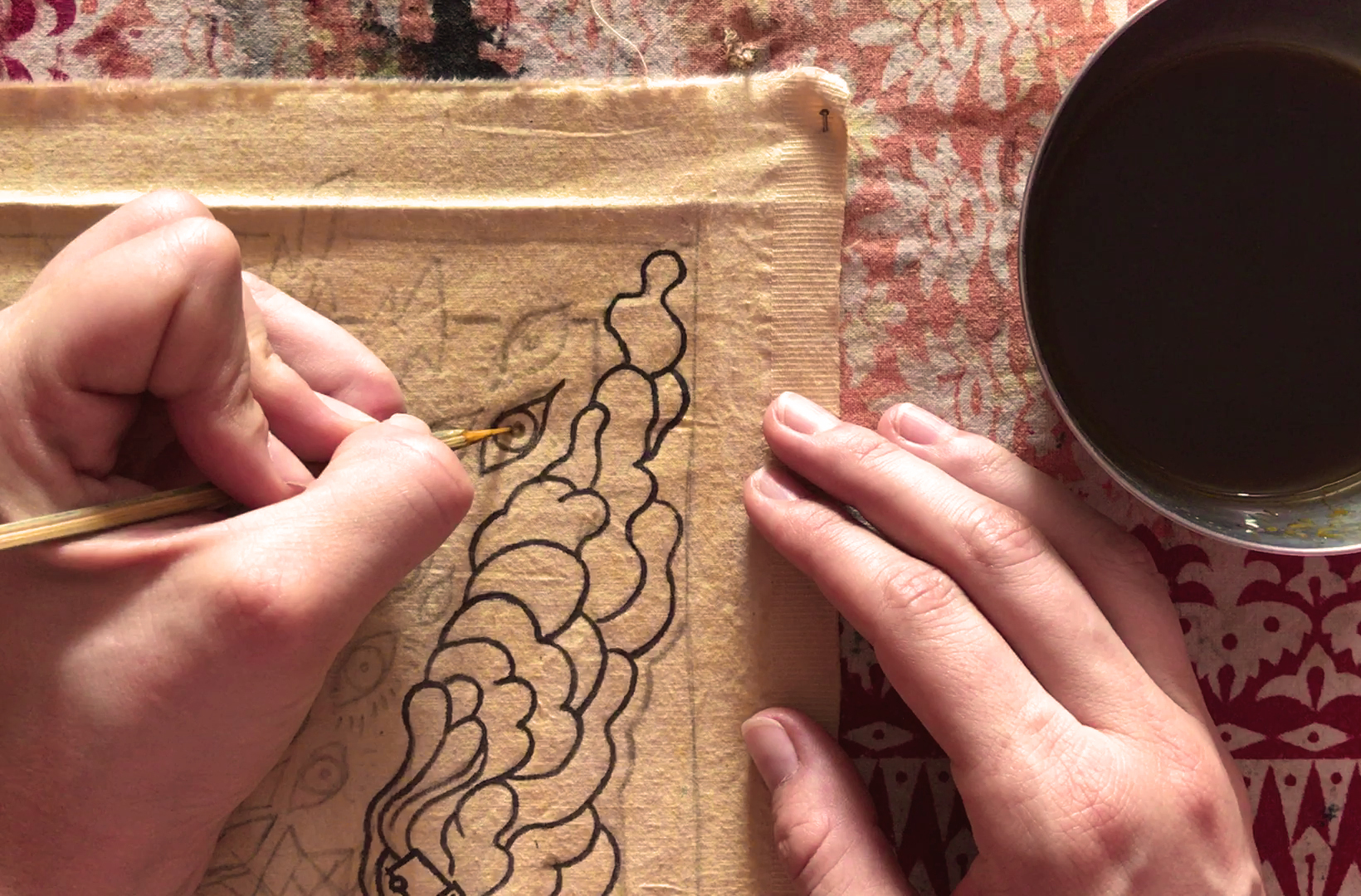 Drawing the outlines with a bamboo stick