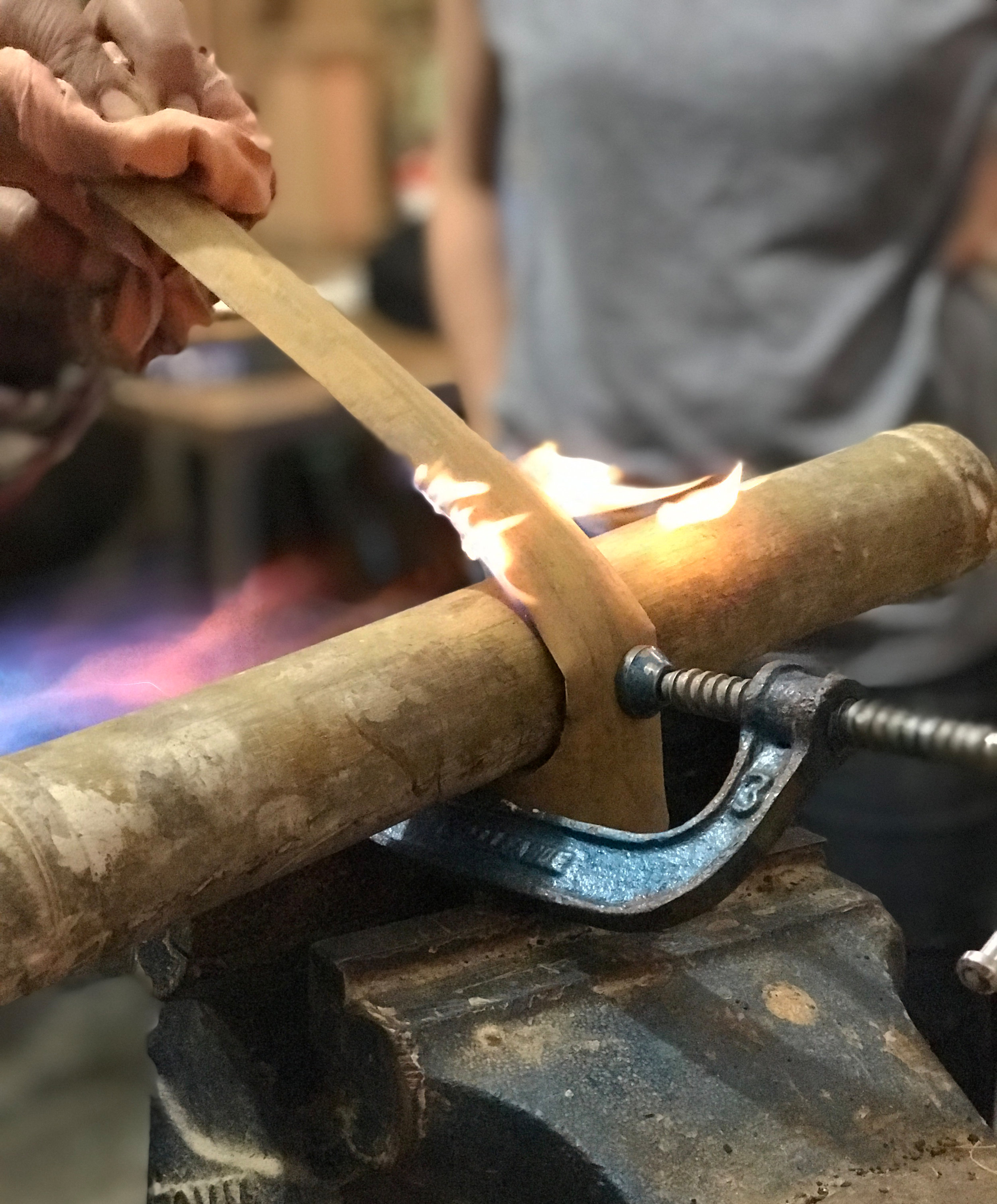 Bending bamboo with heat.