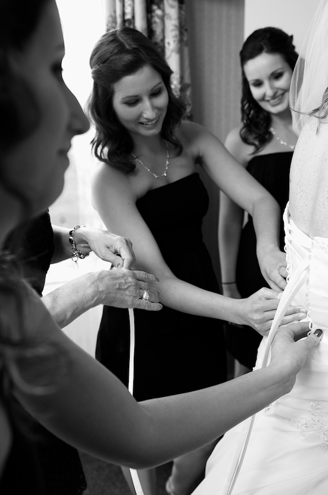 Mom gets the dress laced up.