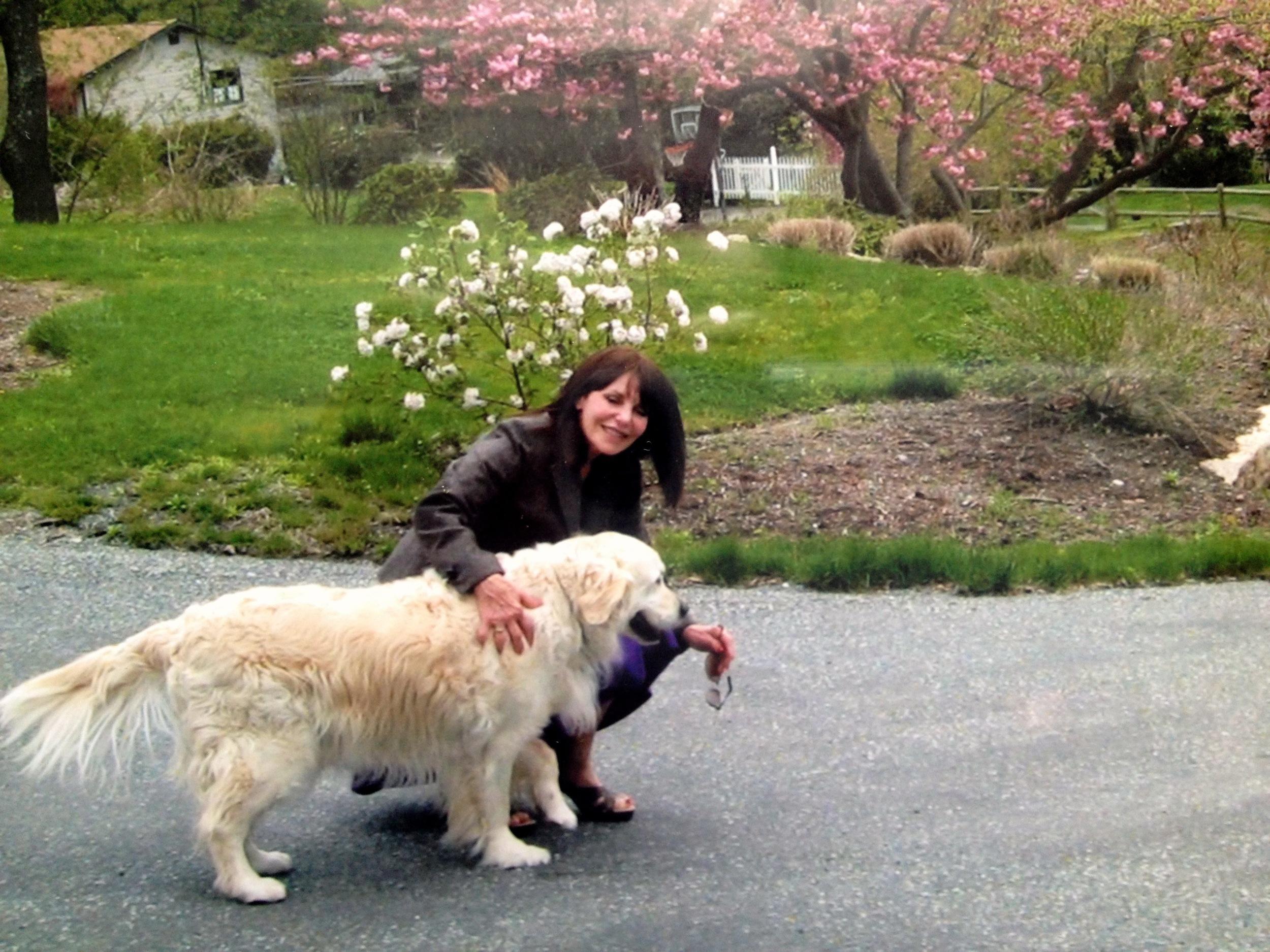 Corrine Healey and her loving dog, Oro.
