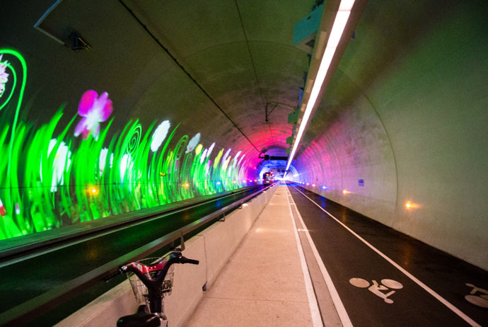 This tunnel, only for cyclists, pedestrians and electric buses connects two parts of the city. Photo via  Almost Landing .