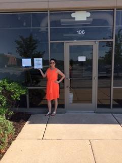 Jennifer Stockhausen rockin' her first building permit in her tangerine power dress.