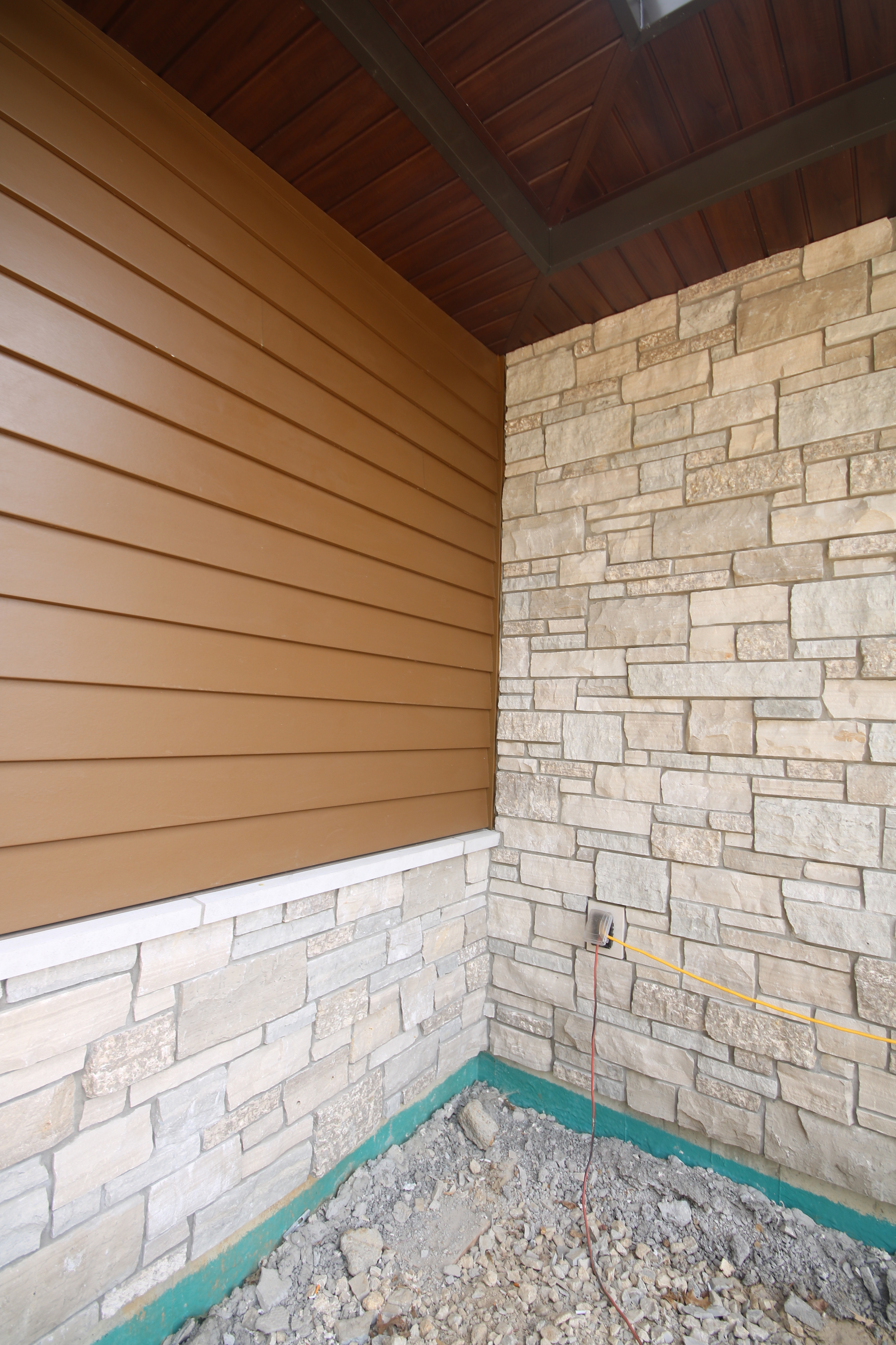 Fiber-Cement Siding, Indiana Limestone, and Sagiper (new to the U.S.) meet under the Standing Seam Metal Roof.