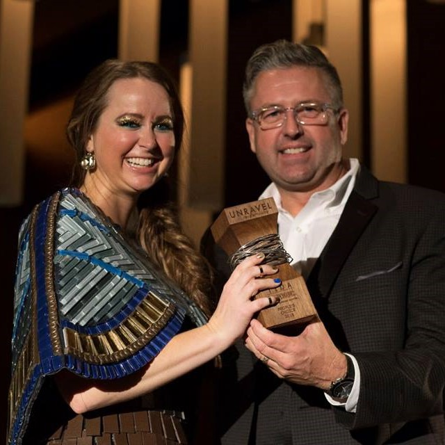 Courtesy of IIDA, Jenn stands beside Larry Richie as she receives the award for People's Choice!