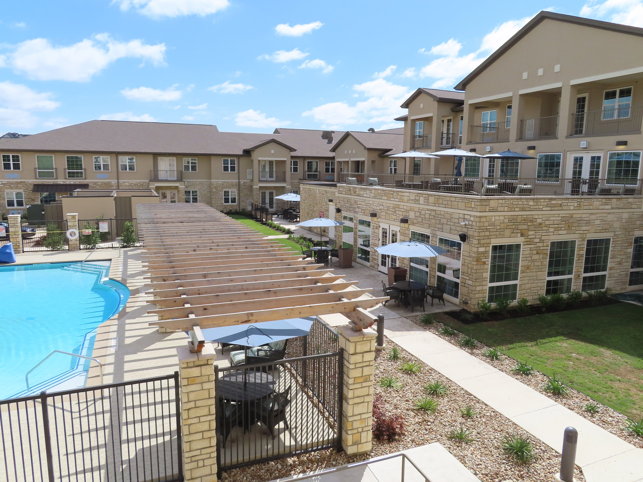 Round Rock Independent Living & Assisted Living Patio Pool.JPG