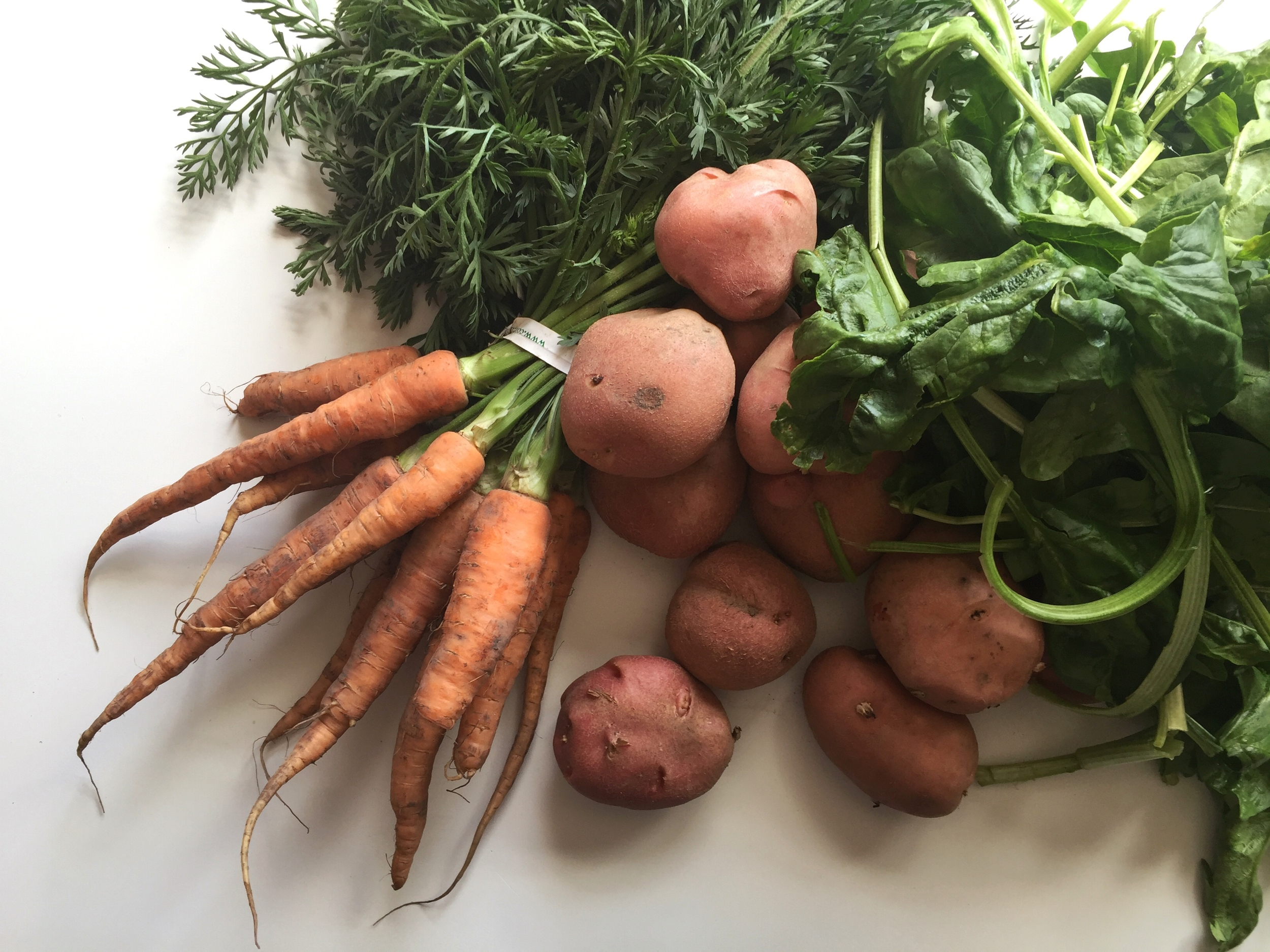 Farmers market potato carrot spinach