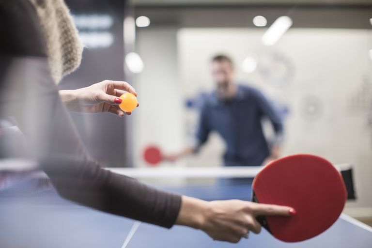 two-colleagues-playing-table-tennis-in-office-break-room-673117017-592611993df78cbe7e959740.jpg