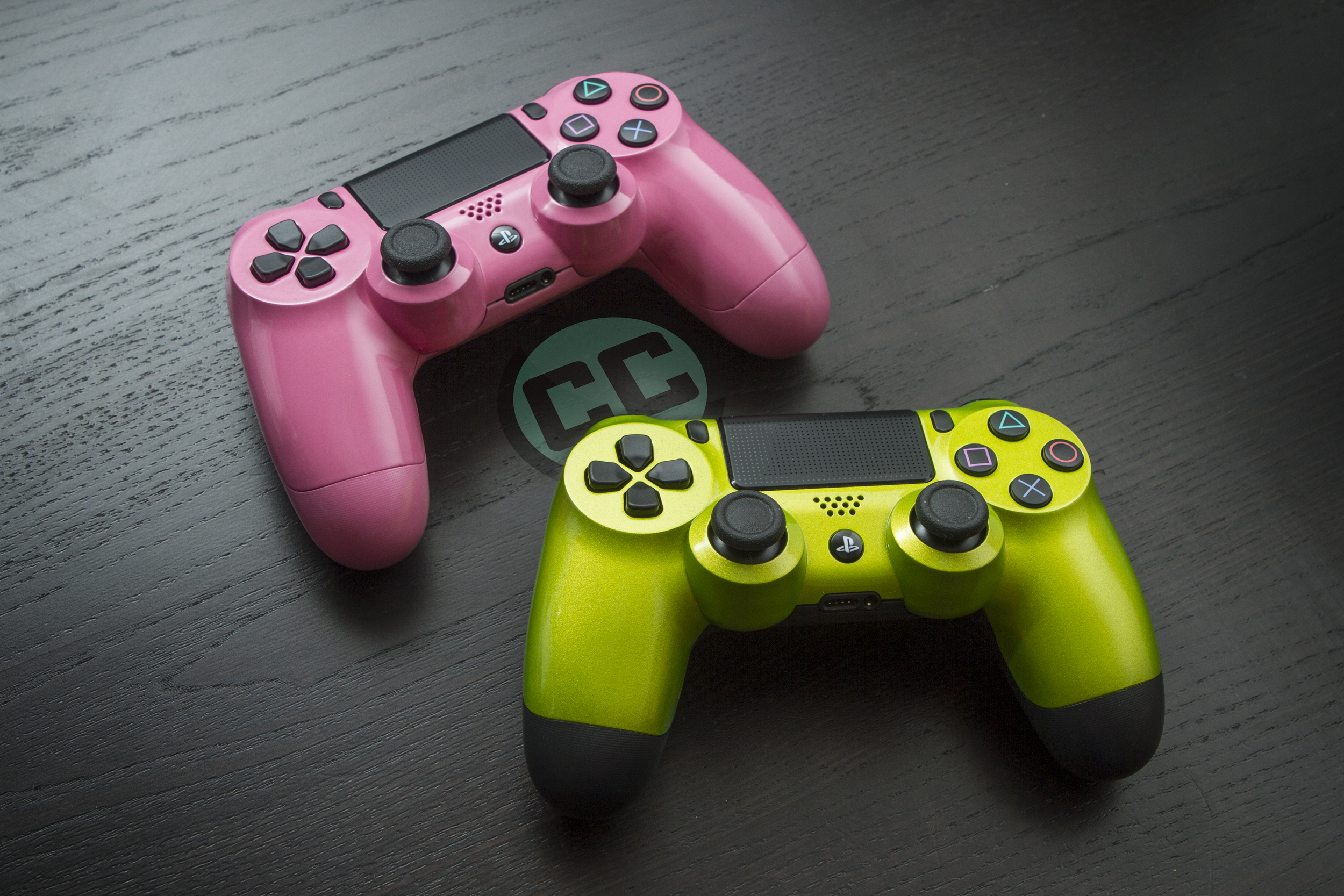 Pink and lime green ps4 controllers