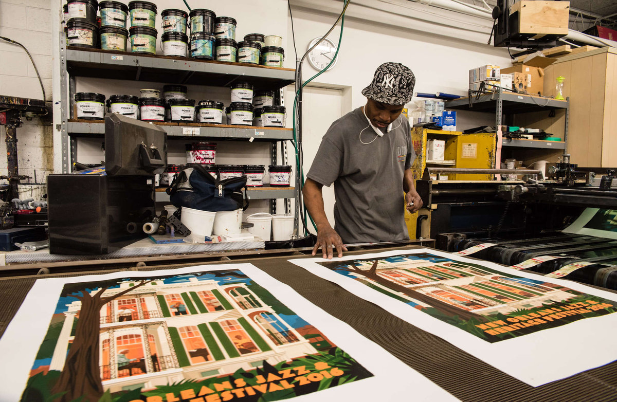Joe Edwards checks the ink at DMR Graphics in West Conshohocken. DMR's posters for the New Orleans Jazz & Heritage Festival have become collector's items.