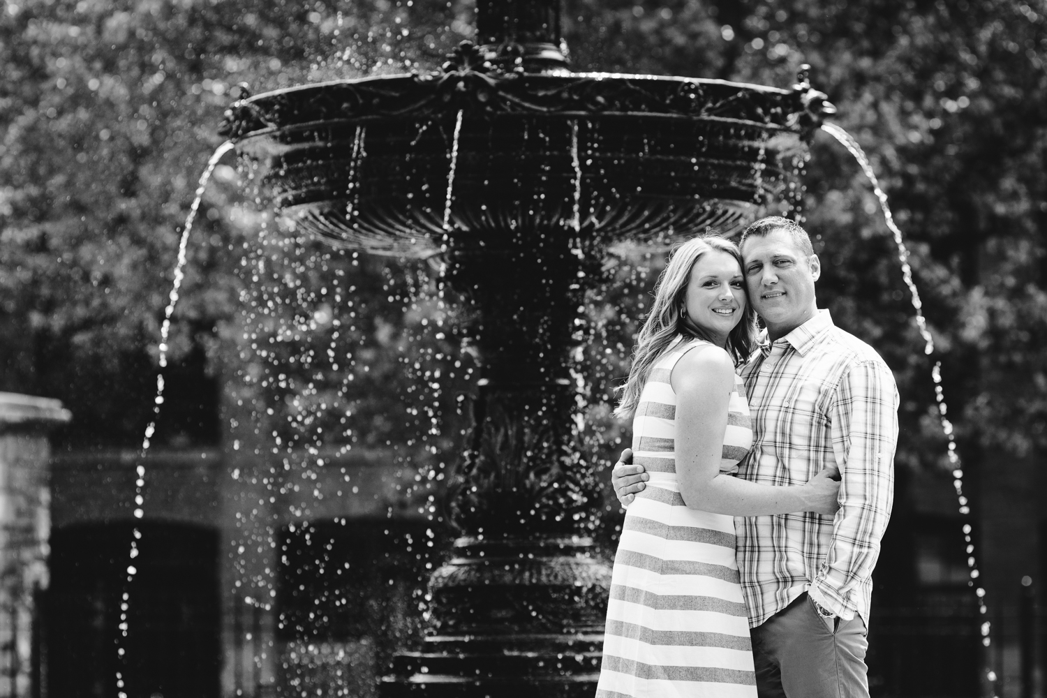 bride and groom in front of Franklin Square fountain