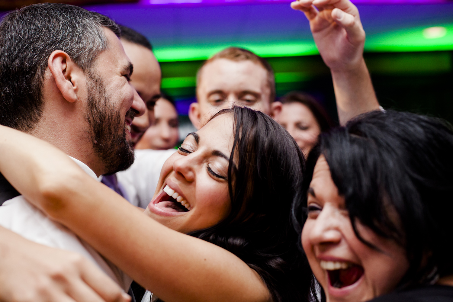 bride and groom share a last dance with friends at a wedding reception