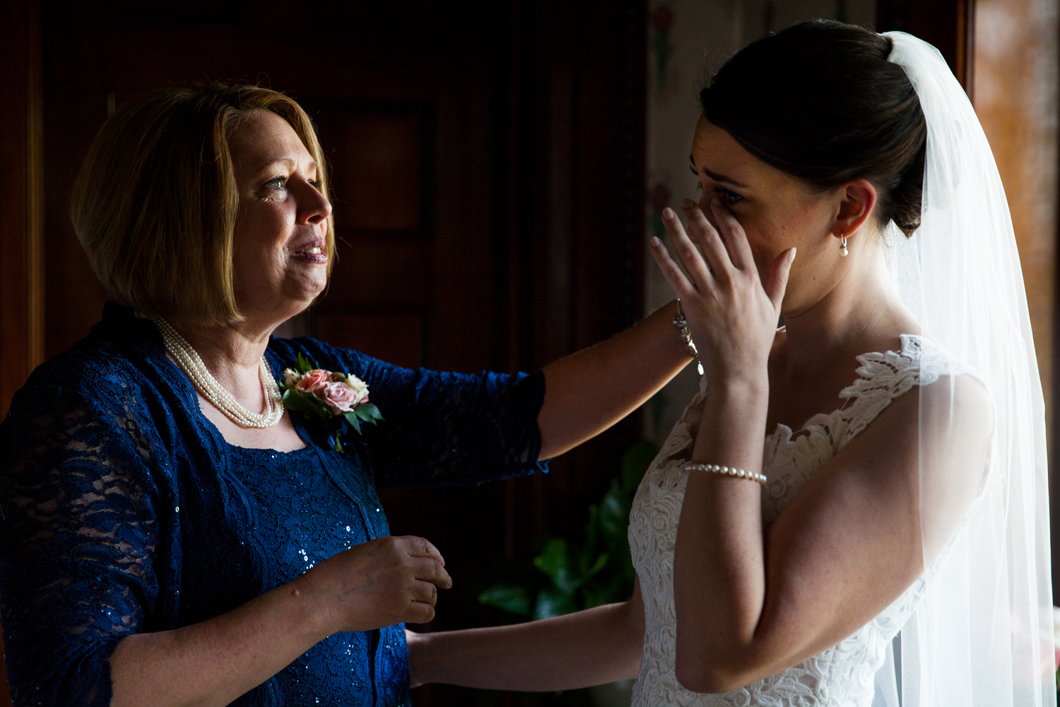 A bride and her mother share a moment before the ceremony in Geneva New York